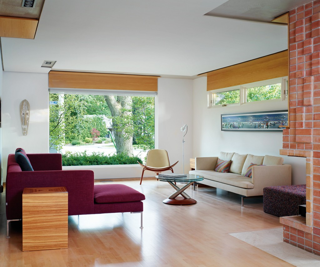 To bring in more light and a better view of the street, a window opening was enlarged by dropping the sill. Windows by Loewen; sofas by B&B Italia from Kiosk.