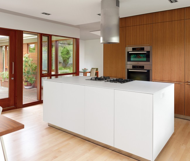 The hub of the home is Bulthaup's b3 kitchen system in laminate and walnut. Stainless steel fan by Sirius.