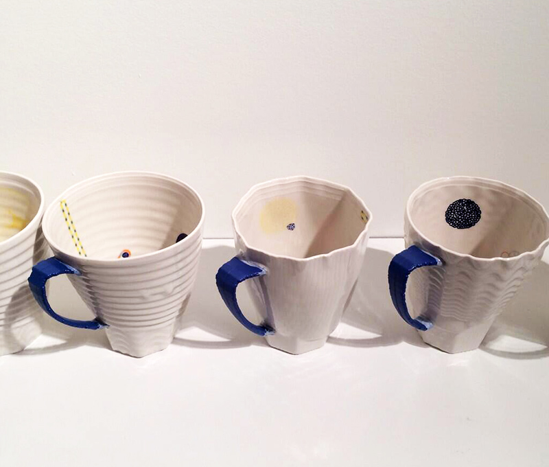 "Ceramic artist Andy Brayman's ""Cups"" on display at Ontario Craft Council Gallery's Hand & Machine exhibit. The blue and white 3-D printed porcelain cups feature intricate motifs and decorations, which were created by capturing the movement of Brayman's fingertips and translating it into custom algorithms. Tagged by Tory Healy."