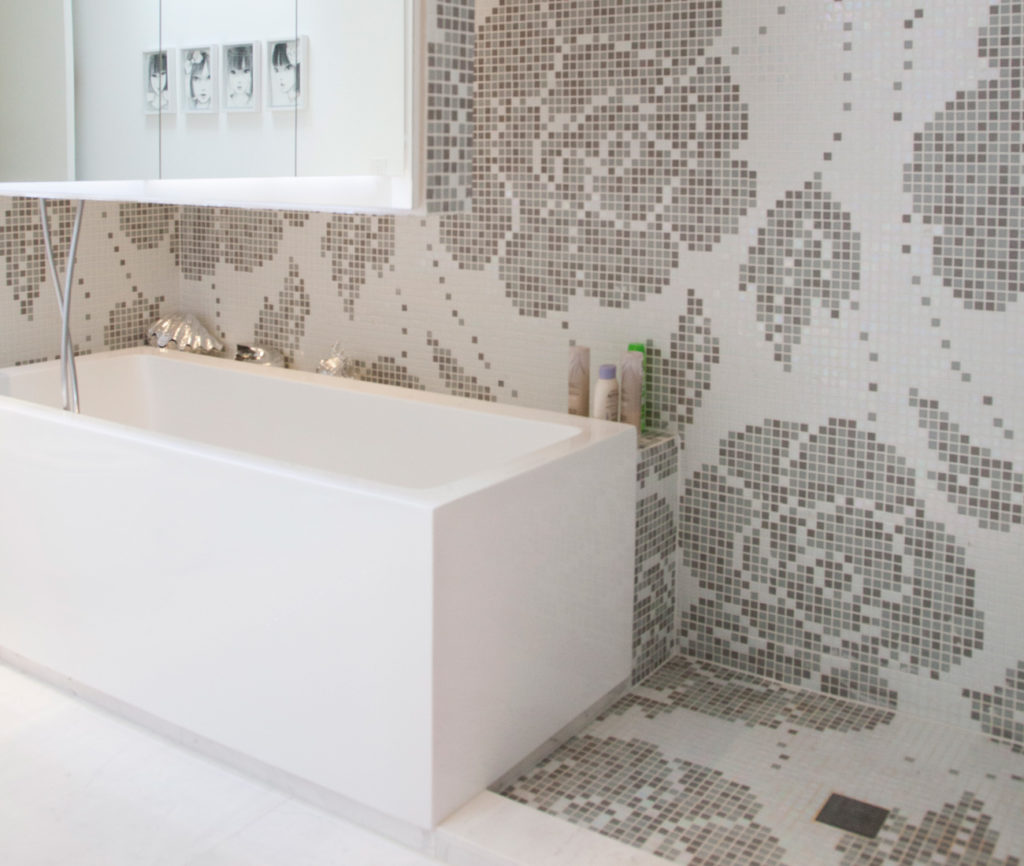 The kids' bathrooms feature a rose motif Bisazza mosaic from Stone Tile. Tub by Wetstyle from Roman Bath Centre.