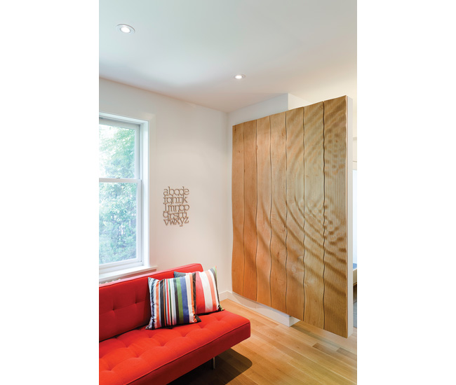 A rippled wall in a home shared by two families marks the transition from public to private spaces. Photo by Alan Hamilton.