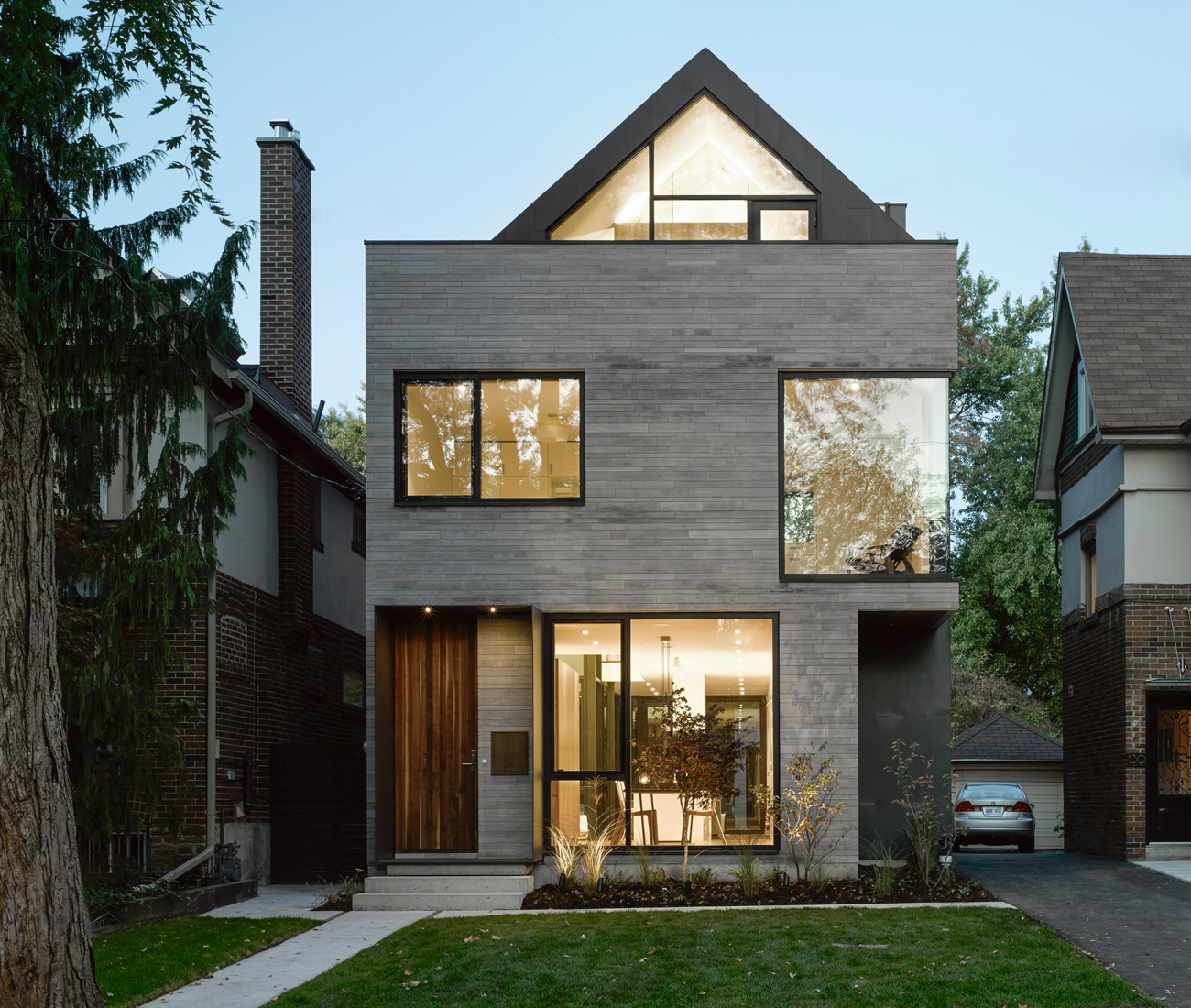 A modern home with a curiously pitched roof