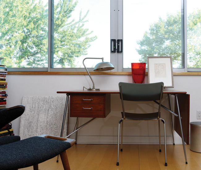 Teak and steelpipe desk by Borje Mogensen (1952); chair by Andrew Jones for Keilhauer; 1940s lamp from the William Campbell Company in Brantford, Ontario.