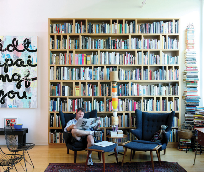"Prokopow estimates he lives with more than 4000 books that cover art, architecture and design history, urban planning, cultural theory, plus hundreds of titles on etiquette, cooking and table setting. The painting on the wall by Emmy Skensved is titled ""I did this painting for you."""