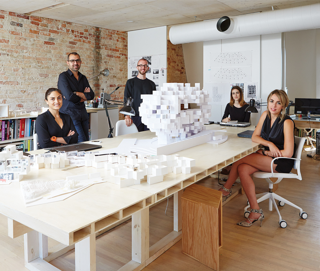 Ja Architecture's team – from left to right, Behnaz Assadi, Nima Javidi, Thomas Mustel, Sarah Hunter and Hanieh Rezaei – circle a proposal for Guggenheim Helsinki.