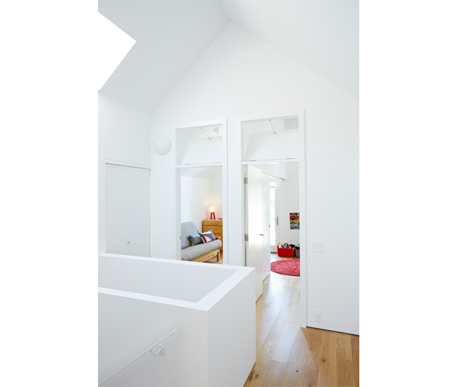 Upstairs, a motorized, two-metre-long skylight and transom windows above bedroom doors boost airflow. A sliding door dividing the daughter's room from a guest room allows the two spaces to be combined when desired. Pillows, light and felt baskets from DWR, EQ3 and RADform.