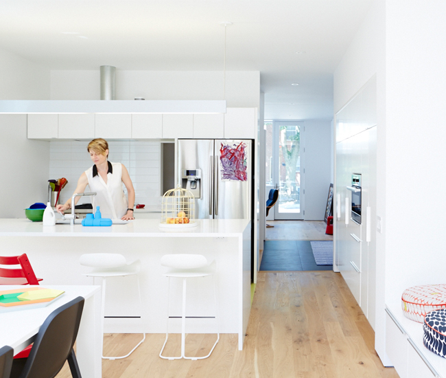 IKEA built-ins house an oven and the pantry, then step down to banquette-style seating. The supersize island – three metres long, one metre wide – is topped with Caesarstone. Stools from Suite 22 Interiors; tabletop items from DWR, Neat and RADform.