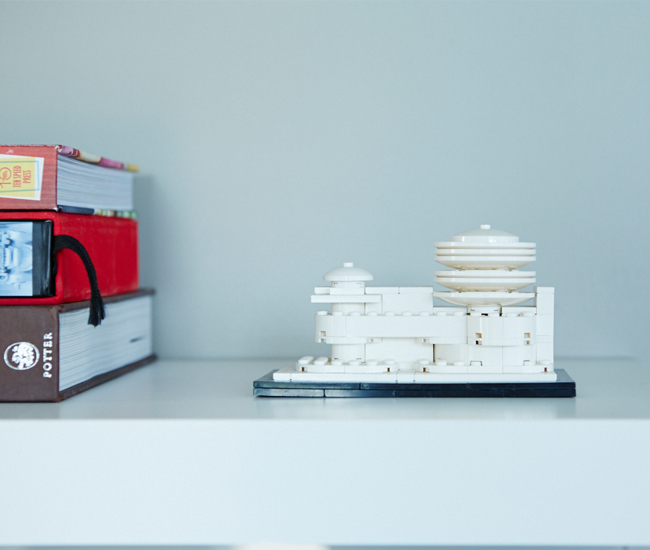 Jennifer and Jill have a thing for Lego kits and vintage figurines – they're dotted throughout their home. An architectural model of NYC's Guggenheim holds court in the kitchen.