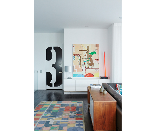 A graphic on the elevator door marks which floor (of four) we're on. Rug from Made; painting by Oli Goldsmith.