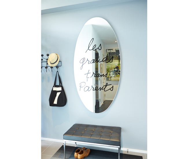 Mirror from Palazzetti; Eames coat racks from Ella+Elliot.