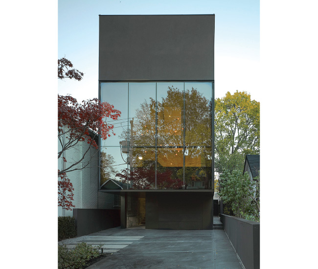 The Forest Hill home features a black steel exterior, cantilevered kitchen and hidden side entrance. Photo by Ben Rahn/A-Frame Studio.