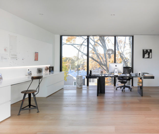The made-to-order home office overlooks the treed back patio. Photo by Ben Rahn/A-Frame Studio.