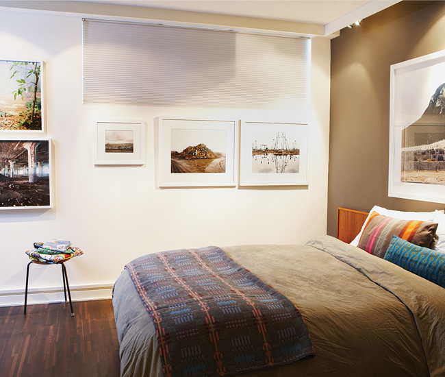 Photos by Corine Vermeulen-Smith and Edward Burtynsky, among others, hang in the master bedroom. Photo by Naomi Finlay.
