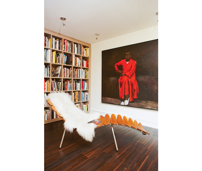 A painting by Lynette Yiadom-Boakye is displayed next to a retro teak lounger purchased at Phil'z. Photo by Naomi Finlay.