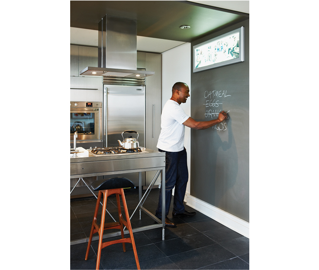 The kitchen's chalkboard wall is perfect for writing out grocery lists. Photo by Naomi Finlay.