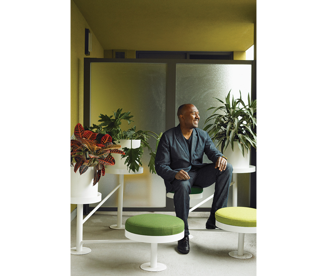 Montague sits among an arrangement of space-age plant stands and patio seats by Domison. Photo by John Cullen.