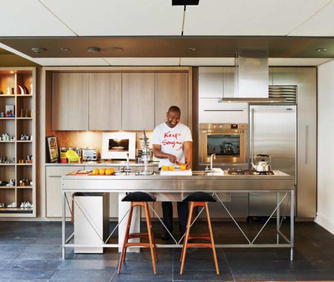 The kitchen workbench by Bulthaup is surrounded by walnut millwork designed by David Peterson and built by Richard Turner. Photo by Naomi Finlay.
