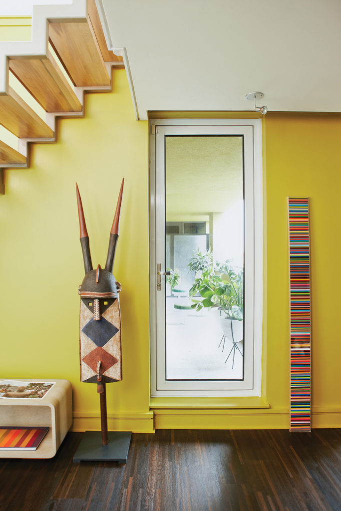The patio doorway is framed with a ceremonial mask from Burkina Faso and Douglas Coupland's pencil crayon sculpture. Photo by Naomi Finlay.