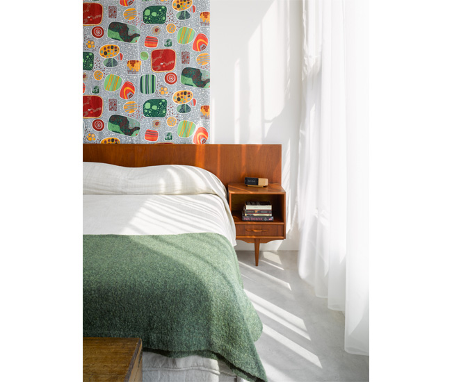 10 Hang patterned textiles to provide bright pops of colour. Josef Frank's linen Terrazzo hangs behind the vintage teak bed with floating nightstands, a G.U.F.F. find. Photo by Ben Rahn/A-Frame.