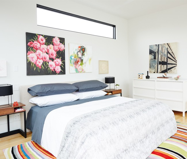 9 Communicate your personality. Bedding by Au Lit; side chair from Klaus; rug from Avenue Road; bed tables from Hollace Cluny; art from Art Interiors; lamps from Lightform. Photo by Naomi Finlay.