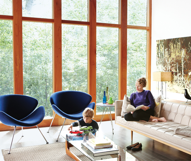 Overlooking Mimico Creek, the living room is airy yet cozy. Artifort's Orange Slice chairs are from Klaus by Nienkämper. The pillows and throw are from Hollace Cluny. Photo by Naomi Finlay.