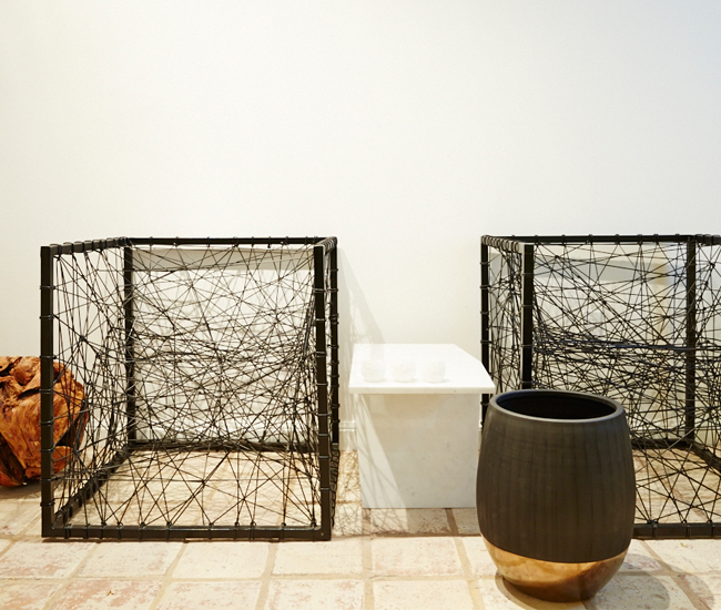 On the floor, unorthodox designs include Phillips Collection's metal-framed Entropy chair ($1,500), which turns a spider web of cords into a surprisingly comfortable seat.
