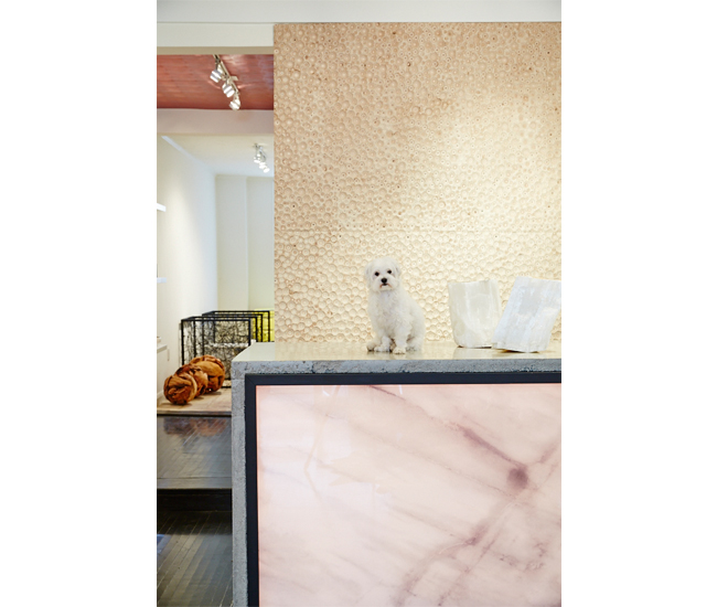 The wall behind the service desk – with its glowing, agate-esque front – looks like coral. In fact, it's raw plywood that was ingeniously furrowed out by California's Soelberg Industries.