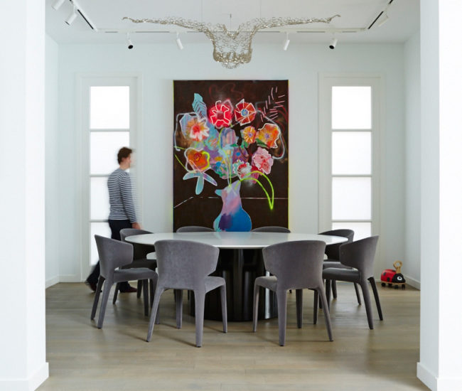 A painting by Thrush Holmes and a sculpture by Rainer Lagemann preside over the custom Corian-topped, steel-based dining table. Cassina chairs from Italinteriors. Photo by Naomi Finlay.