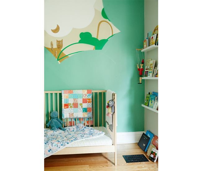 Toddler Sebastien Rabbit's bedroom features a mural by Paquette and picture rails filled with favourite books.