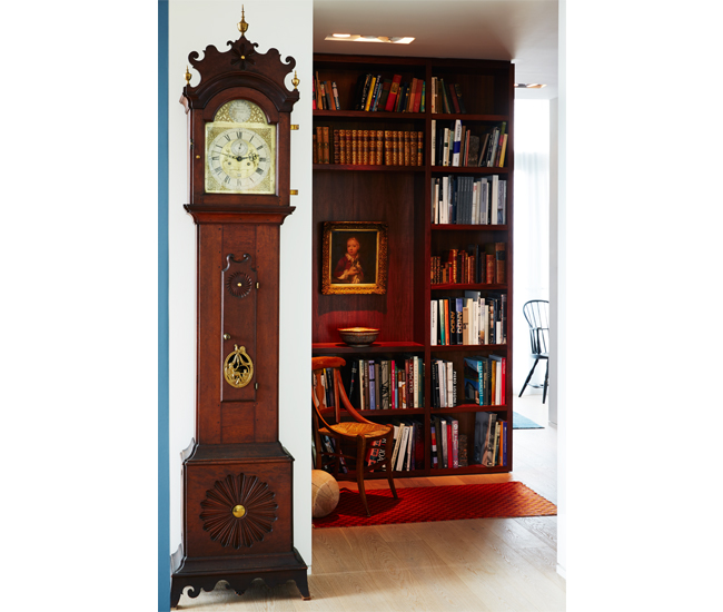 An 18th-century grandfather clock, by Silas Merriman of Philadelphia, stands outside the walnut-clad library. Beyond this, a door opens to the private quarters.