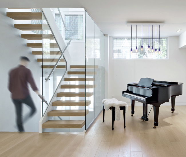 "An open-tread staircase links three storeys. Custom lights are arranged according to Prince's ""Purple Rain."""