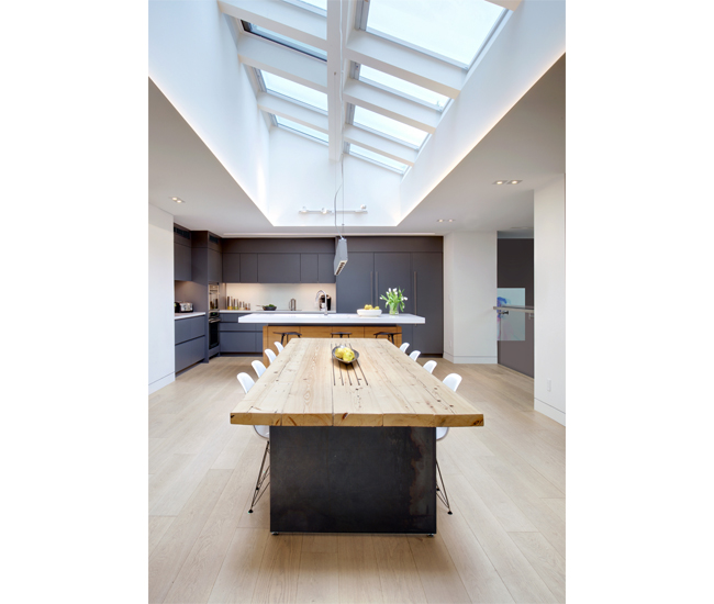 Skylights by Velux brighten the kitchen that overlooks the stage. Table and millwork by Luis Dos Santos Sousa.