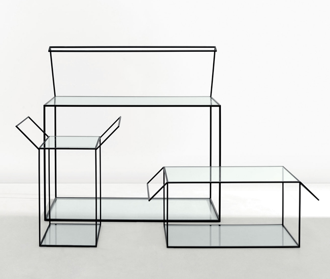 The Gardo° collection for Molteni & C includes glass tables that look like boxes with lids that have sprung open.