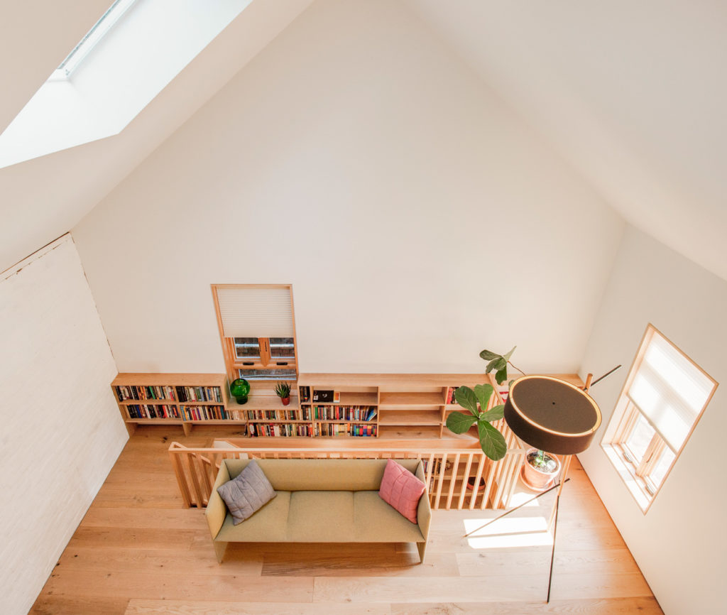 Two bedrooms and a bathroom upstairs are housed in an oak-clad structure. Above will be a lounge accessible by ladder. Sofa from Mjölk; lamp from LightForm.