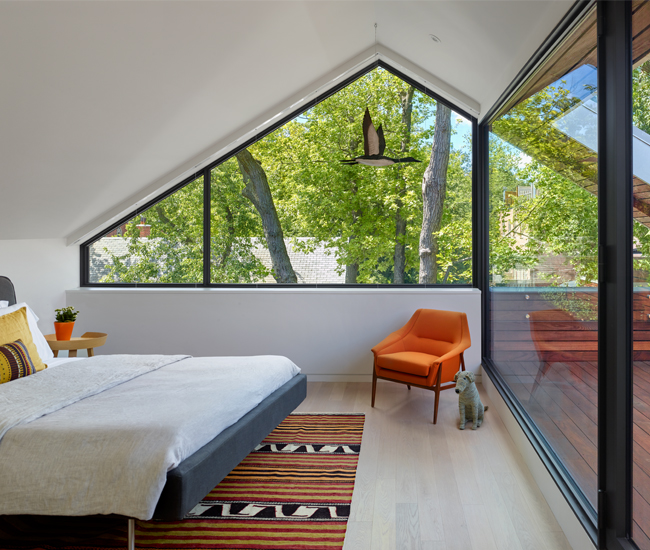 "The west-facing bedroom walks out to the ""Skygarden"". Bed from Urban Mode; window by Just Aluminum & Glass."