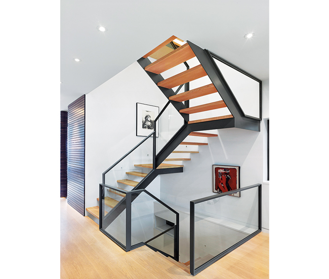 The airy staircase linking four storeys is lit by an operable Velux skylight. Painted-steel frame and guards by Imran Steel; white oak flooring throughout from Moncer.