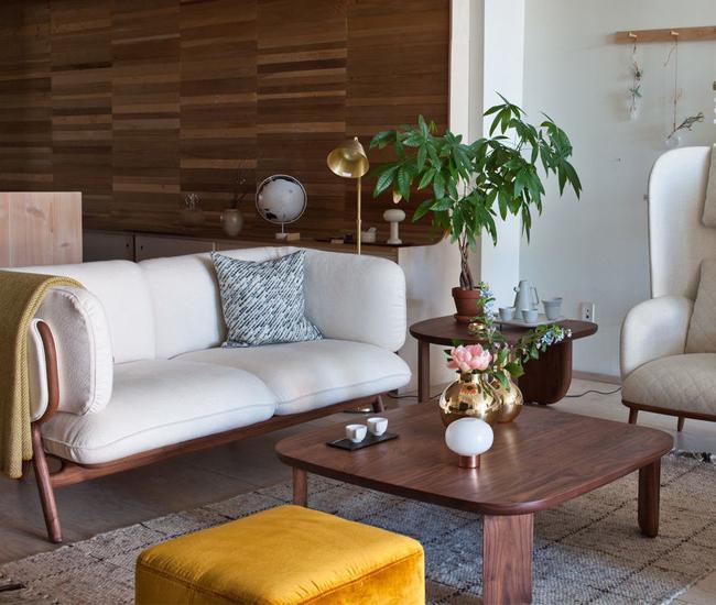 Mjölk's living room vignette includes Nichetto's Stanley sofa, Blanche Bergère armchair, Kim coffee table and Steve pouf.