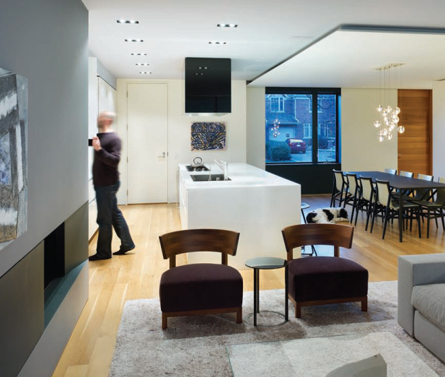 The main floor features a kitchen system by Boffi, a fireplace from Odyssey and a ceiling panel by Viabizzuno.