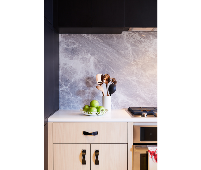 Stone Tile's Nordic Grey backsplash complements oak cabinetry by Mar-Tec Woodworking. Bowl from Neat, towel from Drake General Store. Photo by Naomi Finlay.
