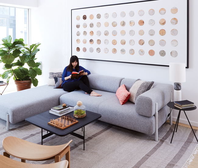 Mason commissioned this birch-bark lunar calendar from artist Christina Ott. Coffee table from DWR, fiddle-leaf fig tree from Dynasty. Photo by Naomi Finlay.