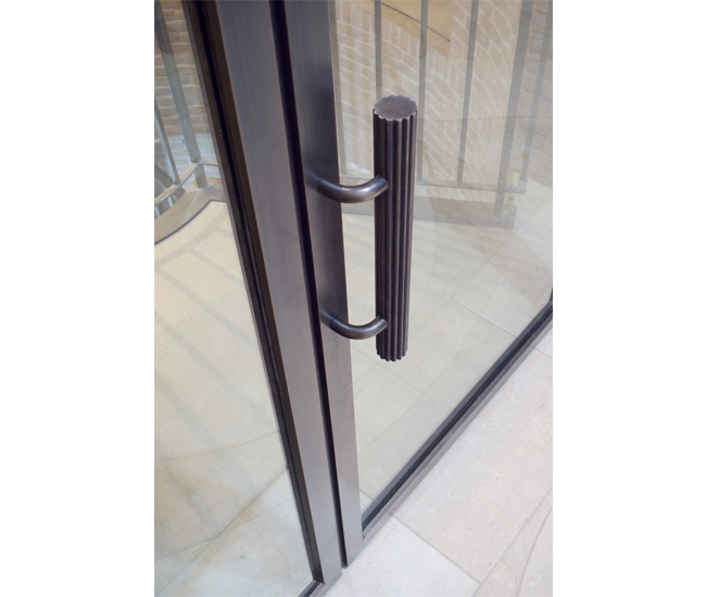 A bronze door designed for a private residence.