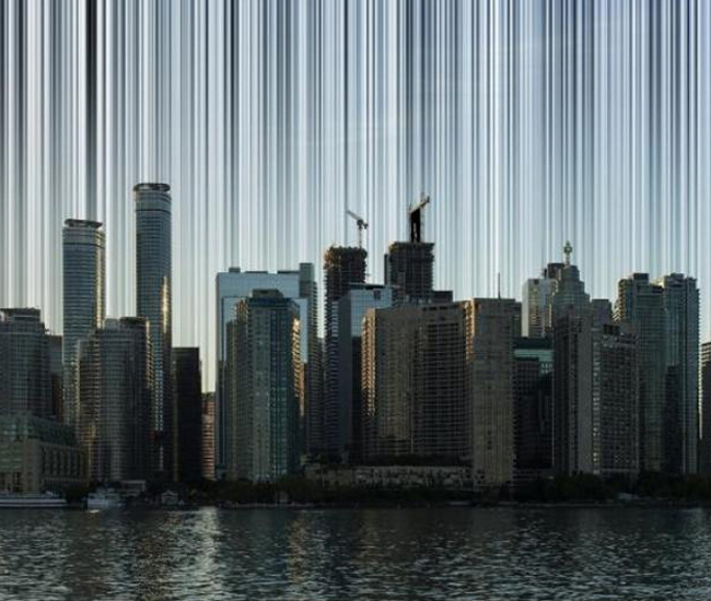 A conceptual image for Electrosmog Toronto, which will use lasers and projectors to represent the invisible electronic transmissions constantly traveling throughout the modern metropolis. On display at Harbourfront Centre.