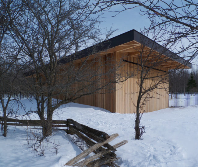 A cedar helipad built in Ontario. The 4.57-metre-tall structure opens via a pneumatic door.
