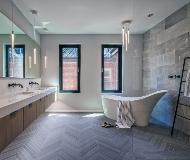 In the ensuite: fixtures from Taps; Stone Tile porcelain flooring; custom vanity and mirrors.