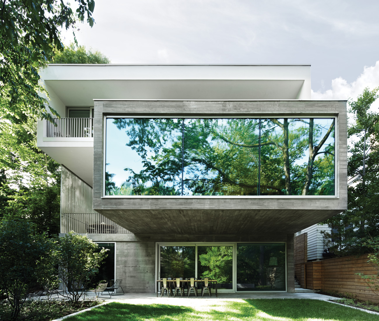Cantilevered Volumes Add Space To A Concrete Home
