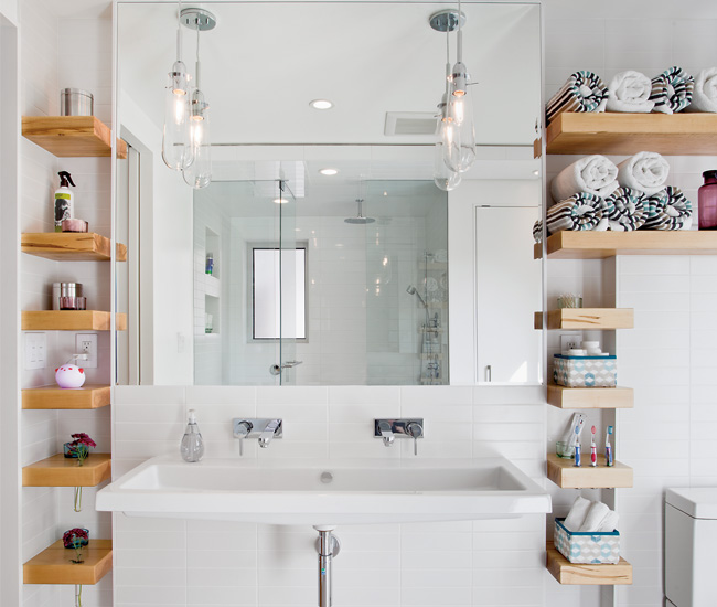 10 Place shelving strategically to provide plenty of space for toiletries. The maple shelves by Space Furniture have routed slots for storing vases, tea lights and toothbrushes. Foating trough sink from Everyfaucet.com. Photo by Scott Norsworthy.