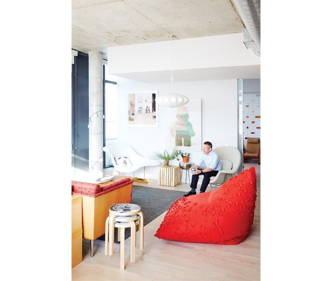 A flashy red pouf by Bev Hisey is joined in the living room by two classic seats: the La Chaise by Vitra and Knoll's Womb chair. Artek stools from Studio Pazo; Brent Comber side table.