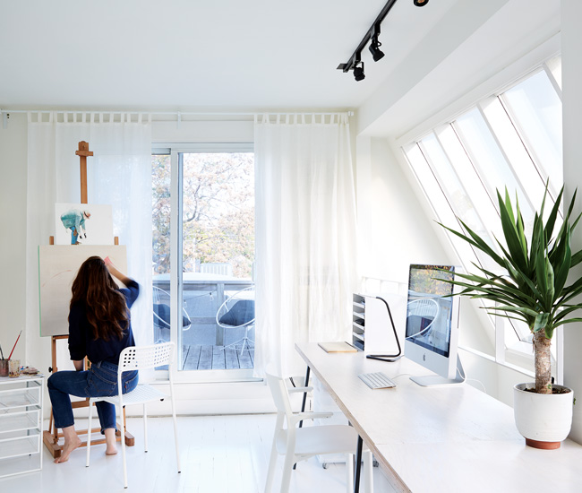 Tilted, floor-to-ceiling windows in Dyer's blank canvas of a third-floor studio create the feeling of an observatory. Chairs from IKEA.