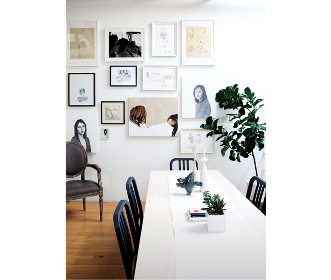 On the dining space's gallery wall are two portraits by Olympia Gayot and a photograph by Paul Sturino, plus works by Dyer. Dining chairs from Elte Market; candleholders from Hopson Grace; stone bear from Cape Dorset Fine Arts.