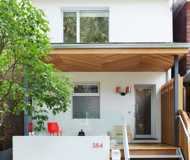 Aesthetic consistency: Cedar cladding with chevron inlay is in tune with the solarium, and a patch of turf blocks nods to intricate interior tiling.
